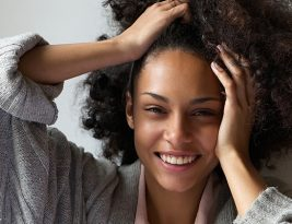 Beautiful Woman Smiling With Hands In Hair